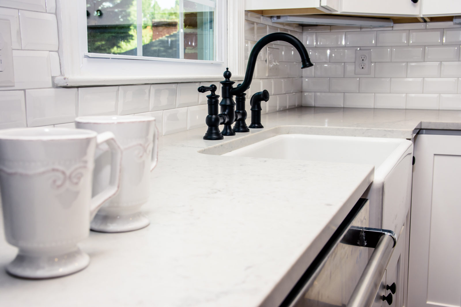 Murray Kitchen, black sink nozzle and knobs