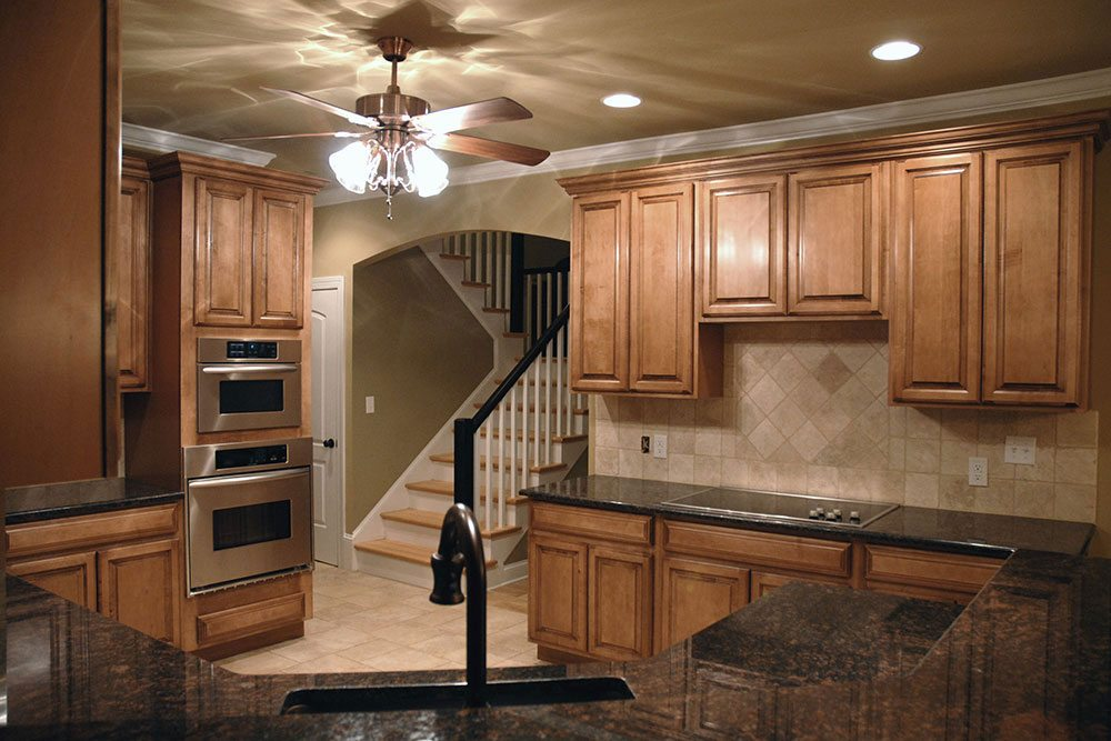 Midland, NC home with wooden kitchen cabinets