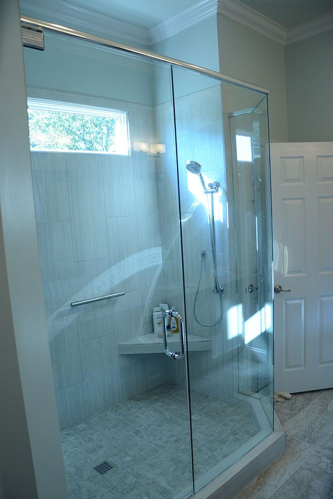 tall shower room with clear doors