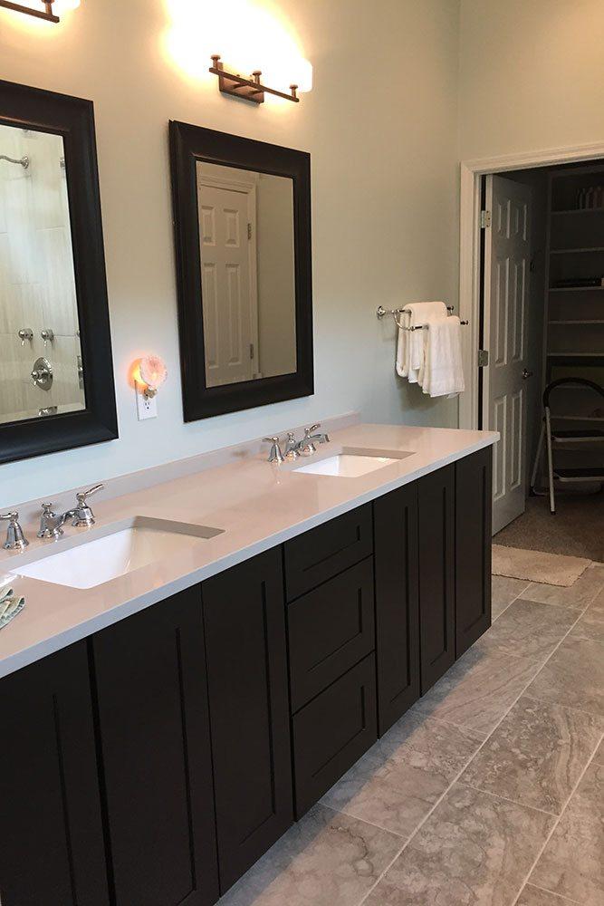 bathroom renovation, black cabinets and mirrors