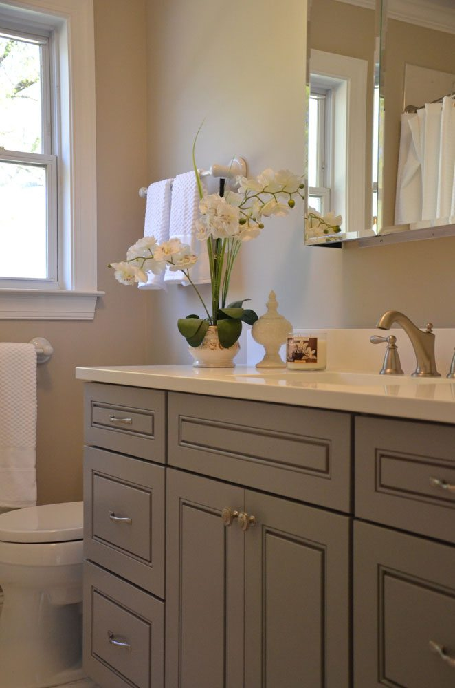 sink with flowers in bath remodel