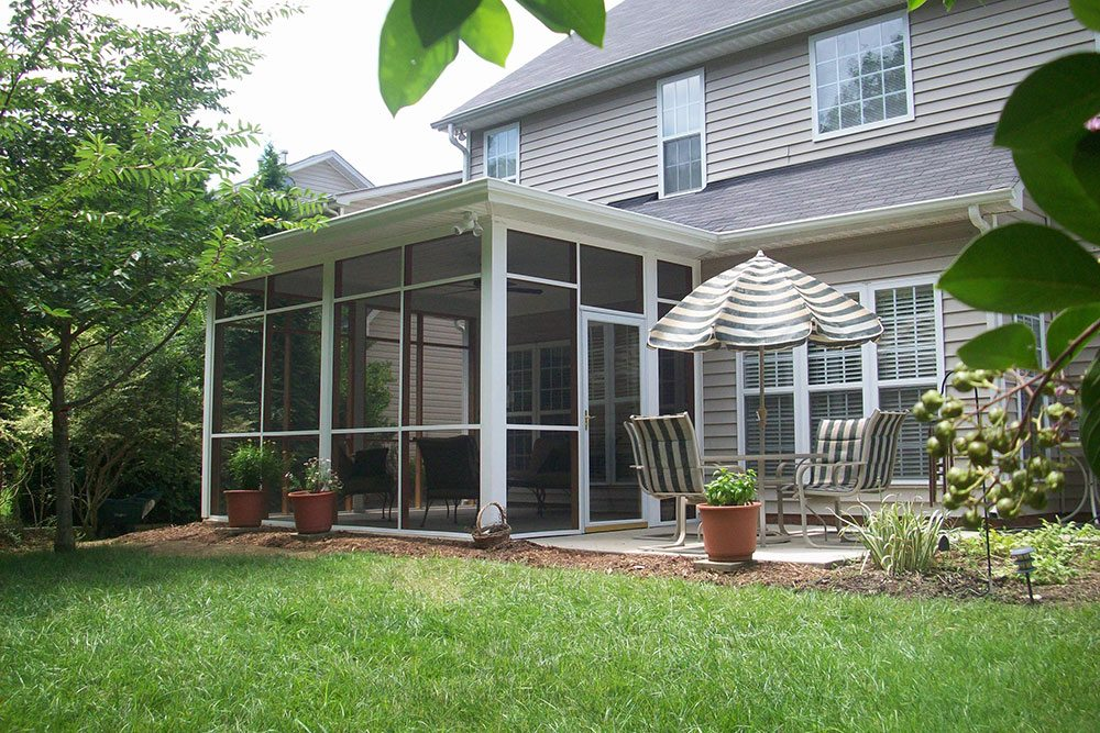 screened porch with umbrella above table