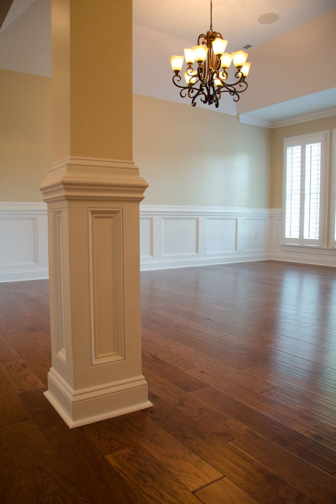Truscott home, wooden floor with column and chandelier