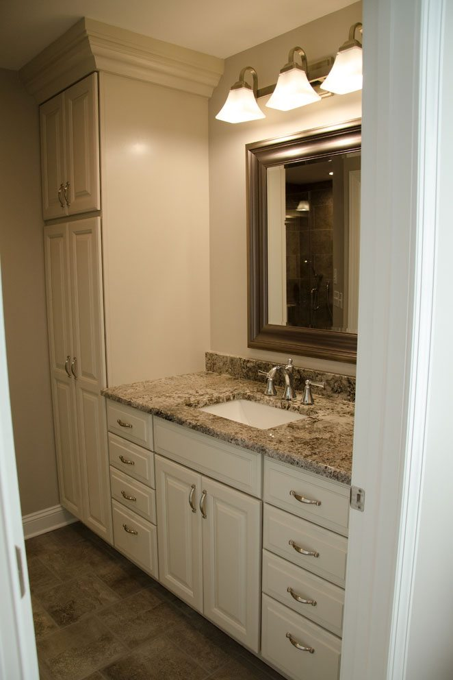 Truscott home, white bathroom cabinets with mirror